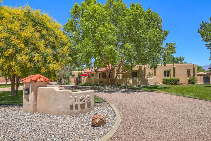 Built in 1996, this custom Jim Beverly designed home sits on 1 acre down a quiet lane in desirable North Valley neighborhood!  Courtyard entry opens to gracious living space plus great room with John Calvin fireplace & smooth plaster banco seating. All one level w/ sunken formal LR with coved ceiling.  Beautiful windows look to lush backyard.  Recently remodeled Kitchen (2013) boasts double ovens, Jennair stovetop, giant island, walk-in pantry and serving buffet. Elegant touches throughout including beamed herringbone ceilings, built-ins, en suite master with TWO closets, jet tub, and sitting area with fireplace.  Breakfast nook plus formal dining room and a built-in buffet - perfect for entertaining friends & family! Many thoughtful creature comforts added for your convenience:  (more...)