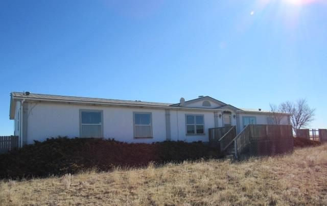 Spacious property located on over 5 acres! Detached garage(s) plus outbuildings for storage, hobbies, toys. Plenty of land for your animals.