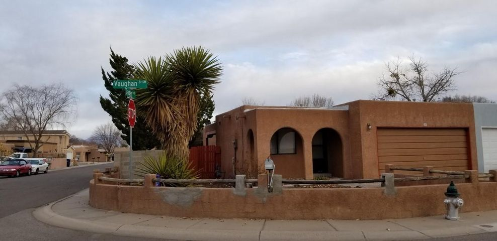 What a Location!..  In the Heart of Los Lunas.. This End Unit boasts a Nice Size Yard  for privacy &  3 Beds, 1.75 Bath.. & a 2 Car Garage.. This is MOVE IN READY.. Upgrades include Paint, Roof, Flooring... Welcome Home!..
