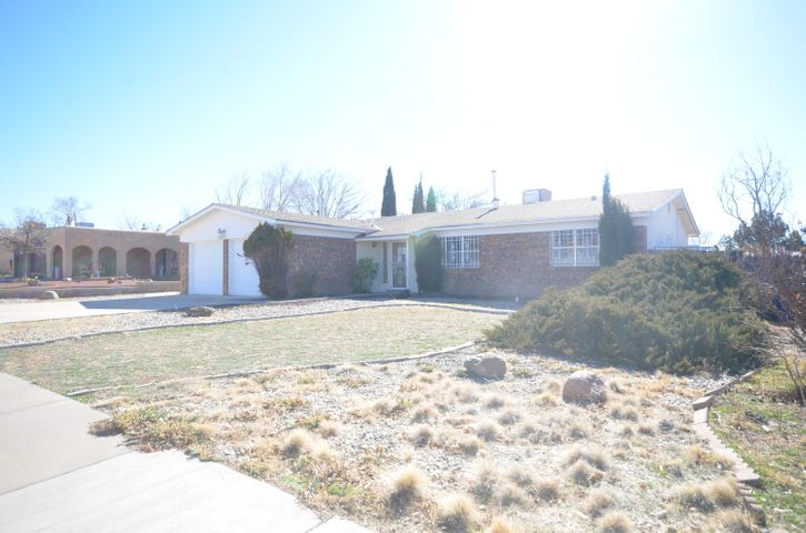 Great Find! Nice home in established NE Heights neighborhood! Formal living! Family living off kitchen that includes wood burning fireplace! Open kitchen/dining with breakfast bar! Master suite features 3/4 bath! 3 good size secondary bedrooms! Quick release security bars on all the bedrooms! Covered back patio ready for the bbque grill! Large fenced yard in back! This home is walking distance to schools & parks! Easy interstate access!