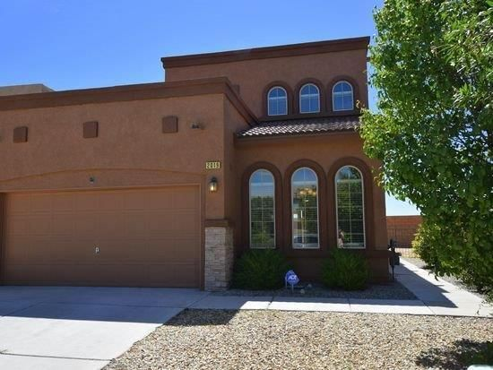 Amazing opportunity in the private gated community of Astante Villas located in the highly sought after neighborhood of Cabazon in Rio Rancho. Exquisite care and cleanliness are apparent in this home that boasts two full Master Suites- one upstairs with a luxury walk-in closet that will surely capture one's attention and one Master Suite downstairs for convenience of direct access to your room from the two-car garage.  An upstairs loft and fireplace for cold winter nights creates the perfect atmosphere for a game area or second living area to entertain. It is easy to love the updated kitchen as well as ''smart'' devices throughout the home. Easy access to Rust Hospital and ''A Park Above'' as well as other popular dining and entertainment options.