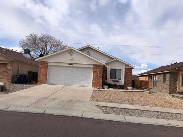 Great house in a nice neighborhood. New paint, new carpet. Recently remodelled. Bright, open floor plan with high Ceilings in great room. Wonderful views of the petroglyphs. Convenient to schools, park, Petroglyphs, nature trails, shopping, Unser and I-40. Motivated Seller. Owner finance/REC available.