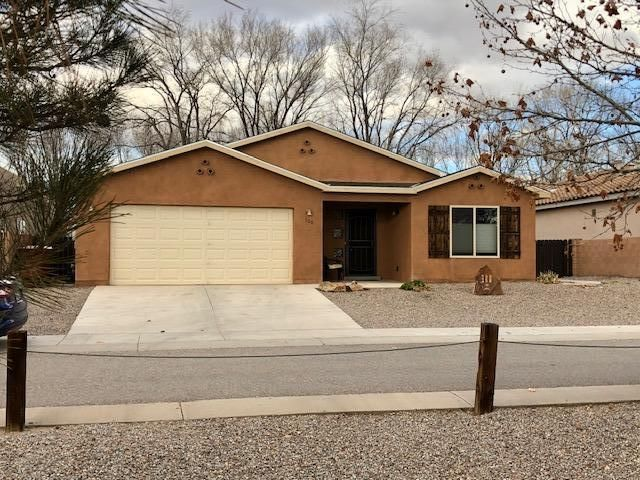 This home has it all --- comfort, convenience, economy! Comfortable, nearly new (built in 2015) 3 bedrooms, 2 baths, den, and living/dining/kitchen Great Room, with sliders to an enclosed patio room overlooking large outdoor patio garden area. LOCATION! convenient Damiano Square Subdivision within walking distance of the Rail Runner - ECONOMICAL with PV solar panels on roof. Gorgeous stone-faced remote-controlled electric fireplace. Cathedral ceilings throughout this contemporary beauty. Incredible kitchen appliance collection: RETRO 1950's Reproduction Appliances - stove, refrigerator, range hood, even the microwave! (Note: seller will exchange or make allowance if buyer doesn't want 'Retro' appliances).Enjoy wonderful Sandia views and sunsets from the oversized windows in the den.