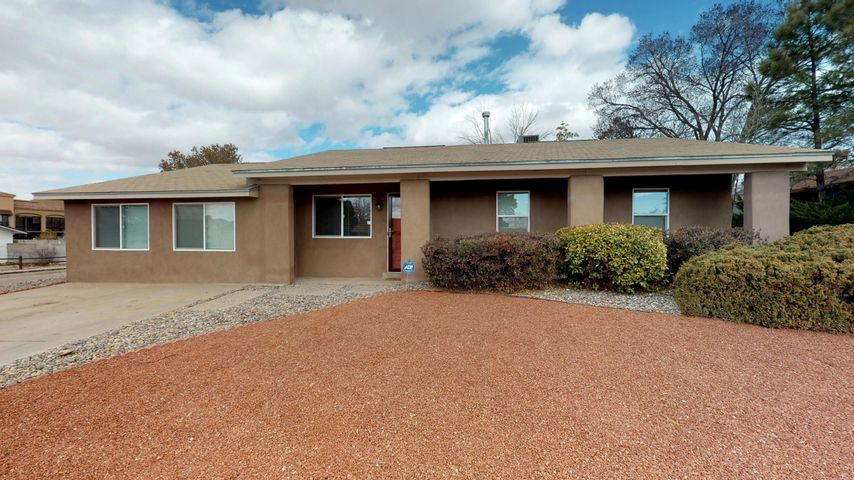 **OPEN SUNDAY 3/24 1-4PM**Beautifully updated NE Heights home on a large corner lot with backyard access and stunning Sandia Views.  Welcoming open kitchen boasts updated cabinets, granite countertops, coordinating glass backsplash and is set up perfectly for entertaining with center island.  Stylish bathrooms with updated vanities, granite countertops and custom tilework with  glass accents in the tub and shower.  Large family room with attached den/office or optional 4th bedroom.  Updated windows let in tons of light.  Stucco has been redone recently along with front landscaping. HVAC was replaced and REFRIGERATED AIR added, plus newer water heater and appliances!  Huge backyard has 2 storage sheds.  Super convenient location close to shopping, schools and restaurants! *3D TOUR*