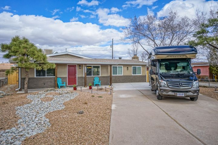 Super charming and 100% remodeled home in the heart of the North Valley. The home is situated on a generous lot with AMAZING views of the Sandias from the back. The home has a new roof, new central HVAC system with new ducting, new evap cooler, new windows, new stucco, new plumbing, new drip system in front, upgraded electrical, new panel, fully remodeled kitchen and baths and so much more! If you're looking for North Valley living at not a North Valley price this home is a must see.