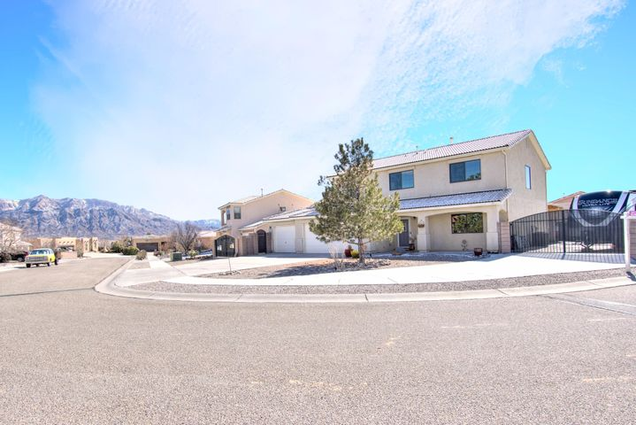Breathtaking Views! Come check out this Immaculate 4 Bedroom, 3 Bathroom Rio Rancho Home, located within a quiet cul-de-sac. Enjoy 2 living areas for all the family fun, a large loft, remodeled kitchen w/ custom cabinets, granite countertops, & high end black SS appliances. Entertainers backyard, with a large covered patio, pergola, and an outdoor kitchen, plumbed for water and gas. Including a Man Cave, at it's finest! Enjoy a heated AND cooled 306 Sqft workshop, located within the 3 car garage! Built in cabinets and storage peg board, for all your organizational needs. To top it off, double sided backyard access, with 2 RV pads to store your toys! Must view to appreciate, schedule your showing TODAY!!!