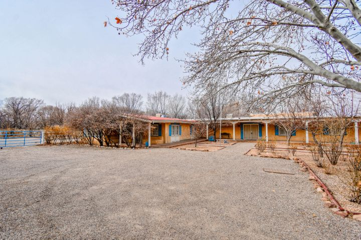 Investors Dream! Custom built ranch style estate located on a sizable 1.33 acres in the North Valley! Home features 4,076sf, 4 bedrooms, 3 bathrooms, 2 living areas, 2 offices, a sunroom and more! This home has unlimited potential and could be your dream home! Barn stalls to house the horses, storage shed, private courtyards and covered patios! This home has the potential to shine and be a spectacular!