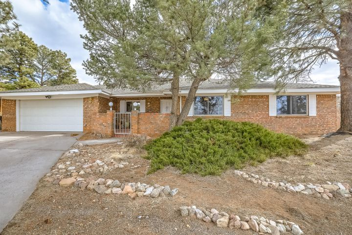 This lovely 4 Bedroom single story home is superbly  located on a cul de sac in Glenwood Hills. Kitchen has been opened up into the family room and boasts a large breakfast bar as well as a dining area. Kitchen remodel includes 5 burner gas stove top & granite tile. Large family room with cozy woodburning fireplace for snowy Albuquerque nights, wetbar and french doors for backyard access.  Gracious master suite with 3/4 bath, double sink vanity and a walk-in closet.  50 gallon H/W heater Nov 2018.  2 combo HVAC units - refrigerated air.  Come home to your own private park with grassy backyard, pool, and mature greenery with fruit trees!  Pool has security cover. Close proximity to conveniences, Tramway paths & mountain trails.  Possession after 5/24/19 due to school age children (...more)
