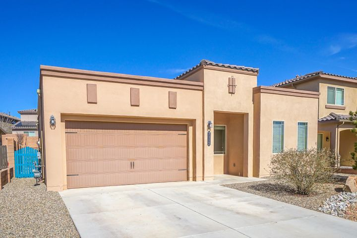 Five year old certified Build Green NM Silver Level semi-custom home with upgrades galore. Kitchen upgrades include granite counter tops, stainless steel appliances, granite island, tile backsplash, staggered cabinet layout with crown molding, a wall of deep pantry cabinets for lots of storage and a skylight. Other upgrades include large format tile in all of the main living areas, coffered ceiling in the living room, 10 ft ceilings with 8 ft doors throughout, tankless hot water heater with water softener, and upgraded light fixtures. Front and back yard xeriscaping with drip system. Backyard has an extended patio with a pergola for dining and a flagstone patio for a fire pit or gathering space. Convenient location close to shopping and top Rio Rancho schools. Quick freeway access.