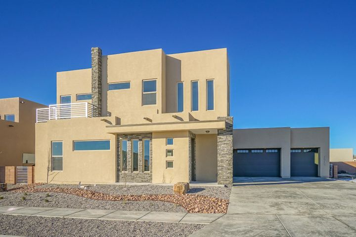 Absolutely stunning new construction home in Petroglyph Estates. This prestigious neighborhood is growing quickly and this home is an amazing addition to the area. With an OVERSIZED 3 CAR GARAGE and outstanding upgrades throughout. including woodlike tile floors, 8 foot doors, stainless steel appliances, tankless water heater, Pella low-e windows, and dual HVAC units, this home will not disappoint! There are 4 bedrooms including a large upstairs master with a spa like bathroom and a mini master on the main level. Upstairs you will find an extra living space perfect for the kids or an office space. The Silver Green Build NM certification also gives the comfort of less expensive utility bills and all around efficiency.