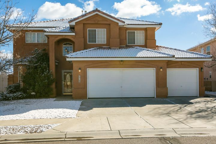 Relax in your private walled back yard and listen to the sound of the fountain as you take in the views of the mountain.  A gorgeous 4 bedrooms 3 full baths home with gas stub out in back yard;  Views of the Sandia; Nice roomy kitchen, easy care yard, fruit trees,;Great neighborhood, and there is a park caddy corner!  3 car finished garage awaits your treasured automobiles.