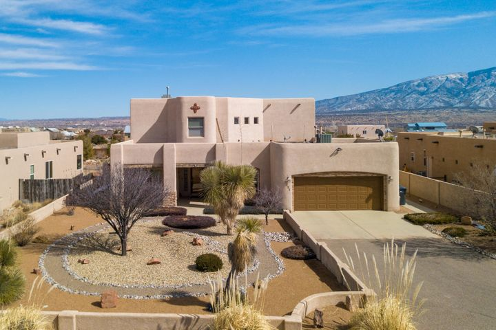 Welcome Home to the endless VIEWS of the Sandia Mountains! This meticulously kept custom home in Rio Rancho's desirable Vista Entrada neighborhood boasts over 3,600sf and situated on .5 acres. *Main level features the master retreat and an additional bedroom. Living area is adorned with a Kiva gas fireplace, wood ceilings, picture windows and custom lighted nichos throughout.  Separate laundry room with a sink and formal dining room. This home has the modern southwest look you've been dreaming of. The stunning gourmet kitchen has newer granite countertops, stone backsplash (2018) and stainless steel appliances (2017).
