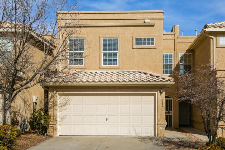 Lovingly cared for 2-story townhome in the highly desirable NE Heights.  Located close to parks, shopping, dining, CNM, hiking, biking and walking trails. New carpet in living area, fresh paint, open floor plan, light and bright, low maintenance front and back yards, with an open patio and walled backyard with lots of privacy in the back. The master suite is huge and features a walk in closet. Both guest bedrooms are generously sized and feature huge closets as well.  Tons of storage throughout this great home!  A secure entry and an attached 2 car garage offer peace of mind.