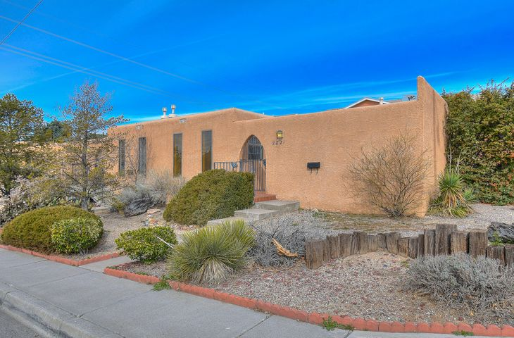 Cute condo in triplex near UNM.  Two bedrooms. two baths. Nice sized living and dining room areas. Updated kitchen offers granite countertops, lots of cabinet space, stainless steel appliances including refrigerator, built-in microwave, gas stove/oven, dishwasher. Stackable washer and dryer also in unit. Mini blinds, ceiling fans, security bars on windows. Nicely landscaped front yard with gated courtyard. HOA includes water, sewer, garbage, insurance, landscaping and roof. Close to shopping, restaurants, hospital and freeway.