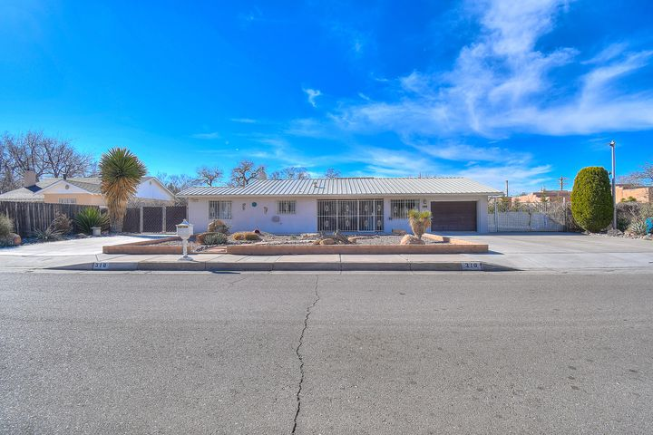 Well maintained single story home on .77 acre lot in the North Valley. Functional floorplan offers plenty of living space.  Large great room w/ gas log fireplace and open kitchen perfect for entertaining.  Kitchen has solid surface countertops, plenty of cabinets, breakfast bar, stainless steel appliances including gas stove/oven, refrigerator, built-in microwave, dishwasher, family dining room. Office with 1/2 bath could serve as 4th bedroom. Family room w/ gas log fireplace provides a second living area. Master bedroom with 3/4 bath plus two additional bedrooms and full bath. Enjoy outdoor living in the screened in patio with hot tub. One car attached garage . Huge backyard has 4 car detached (tandem, RV) garage/workshop, one car carport, storage shed. Irrigation rights. BY access.