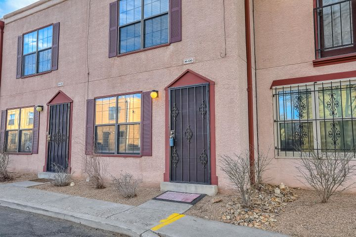 This NE heights condo is move in ready with 2 master suites upstairs, each having its own bathroom.  Laminate flooring in the spacious living area and tile in the kitchen.  The dining room has sliding glass door to a private courtyard.
