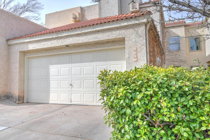 What a wonderful Townhome in the sought after Torrey Pines addition of the Tanoan Country Club Community**Raised Ceilings and Lovely Fireplace add to the livability in the Spacious Sunken Great Room**Beautiful Ceramic Tile**Separate Dining Room overlooks the Courtyard Entrance**The Updated Kitchen has Top of the Line Stainless Steel Appliances including Double Ovens and a Breakfast Nook with Built-in Cabinetry and a Door opening to the private covered Patio**The Master Bedroom has a private balcony, large walk in closet and updated Master Bath with Separate Garden Tub and Large Shower**Light and Bright Open floor plan with BR/Study on the Main Floor**Large Bedrooms**Commercial TPO  Roof**Very Private Backyard for intimate enjoyment of the outdoors**You don't want to miss this gem!!