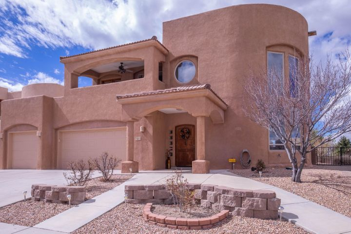 QUINTESSENCE at its very best!  Custom two story Southwestern Beauty. Large Corner Lot, Dramatic, Soaring 24ft ceilings,  perfect to frame those Sandia Mountain VIEWS, Kiva Fireplace, Custom Tile.  Flexible layout includes 2 ensuite Bedrooms (on main and upper level).  Master Bedroom with Balcony,  a Truly Unique home that includes a fully finished basement with bathroom, the Quintessential bonus room.  Wood and tile flooring- no carpet.  Excellent Floorplan with open concept kitchen, Gas Hookup for Cooktop if you Wish. Backyard Is a joy on this oversized Lot, Heated Saltwater Pool, Hot Tub, Covered Patio. Backyard access possible,  3 Car Garage.  Located in Double Eagle/Desert Ridge/La Cueva School Districts.  Walk to the Park - A Rare Find ! plan to see this incredible home today.