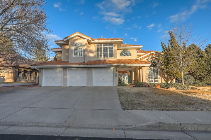 Gated Community. Updated and Upgraded. Hardwood floors. Cherry cabinetry. Granite counter, built-in cherry cabinet in breakfast room. Two fireplaces. Formal dining room. Large bedroom suite w/separate sitting room and newly remodeled master bath. Mature landscaping. Oversized patio and new upstairs Trex deck. Downstairs bedroom with built-in bookcases and cabinets doubles as home office. Upstairs bedrooms with Jack & Jill bath. Upstairs laundry room.