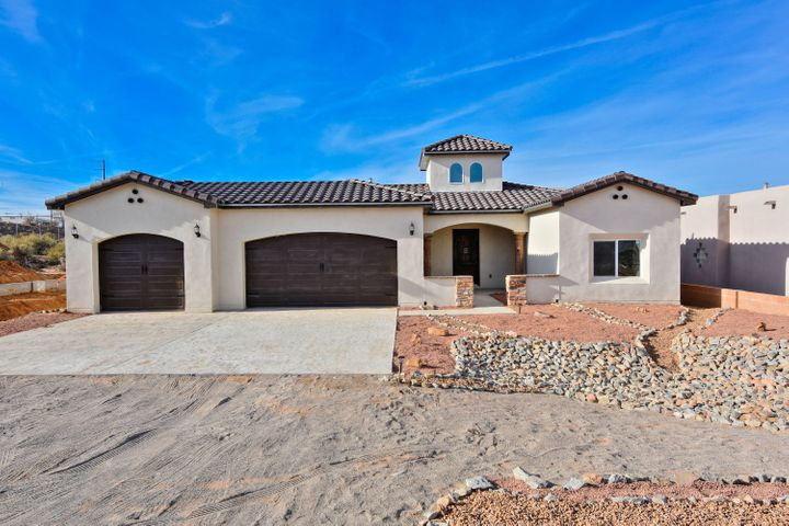 Brand new Enchanted Custom Homes beauty in the heart of Rio Rancho on a large .50 acre lot with mountain views! No HOA! Home features 2,314 sf with 3 bedrooms, 2.5 bathrooms & a 3 car garage! Great open floor plan with raised ceilings! Beautiful open living area with custom gas fireplace with a cultured stone surround! Chefs kitchen with upgraded cabinetry, quartz countertops, stone backsplash, refrigerator, range, microwave, range hood, pantry, and huge island with seating area, Dining area right off of the kitchen. Beautiful over-sized master suite with a private spa- like bath. Bath hosts his/hers sinks with granite top, a large garden tub, walk-in shower with a custom tile surround & closet w/ laundry room access! Covered patio & RV parking available in the front!