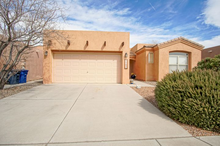Beautiful single story, pueblo style, one owner, well cared for home in desirable Vista Del Norte! 3 Bedroom, 2 bath home includes great room, dining area and  breakfast nook.Custom decorative tile as backsplash and accent in kitchen with pantry and separate utility room. Full size stackable washer/dryer included as well as refrigerator. Has new 40 gal water heater (Oct 2018) and recent water softener. Master shower is ADA ready. Refrigerated air, alarm system, surround sound and ceiling fans with remotes add to the value and comfort of this wonderful home! Enjoy the covered back patio and Sandia Mountain views in your low maintenance backyard with automated drip system!  There are 3 parks in the neighborhood and easy access to the heights, the valley and I-25!