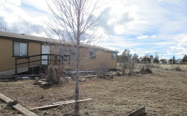 3 bedroom, 2 bath manufactured home on 3 quarters of an acre. Lots of potential! Easy freeway access. Close to shopping and schools. Sold as is where is.