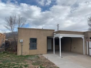 Great opportunity to own this cozy three bedroom two bathroom townhouse. This property is conveniently located near the heart of Bernalillo. Close to the freeway, shopping, restaurants, casino, rail runner, etc. Nice blank canvas that could use a little personal touch in order to be the perfect home. Nice front and back yards with alley access through the rear. Private driveway, So many possibilities. The perfect home for someone that is looking for a great deal! Please see LO/SO *** PRICED AT WHOLESALE!!!