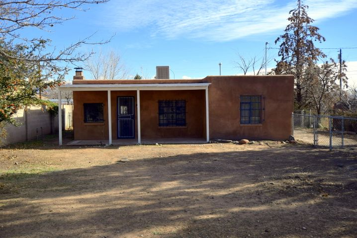 Charming, updated 2 bedroom, 1 bath home in the heart of the North  Valley.  New kitchen cabinets, granite counter tops, flooring, paint and appliances.  Cozy wood burning fireplace.  Large lot with back yard access ready for landscape.  Detached storage shed with electricity.  Near schools, shopping and minutes from downtown.