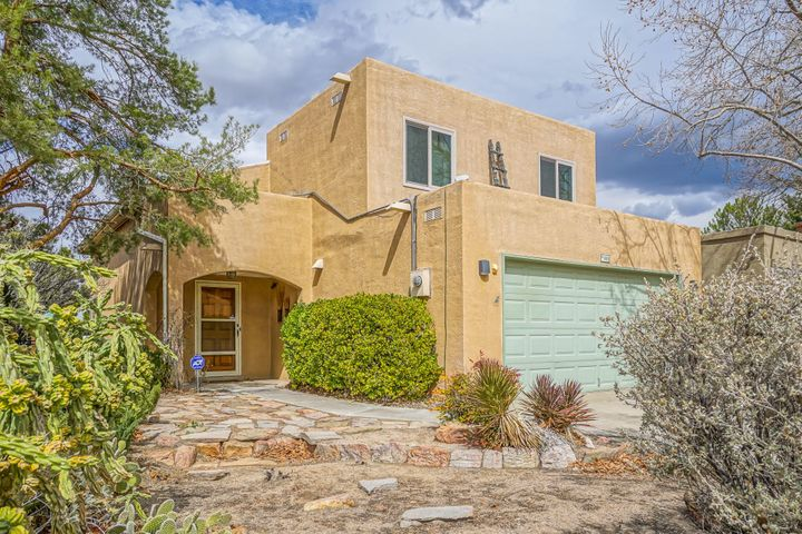 Outstanding Northeast Heights Location... Super Convenient... Close To Shopping, Restaurants, Parks, Walking Trails, and Schools... Enjoy Enchanted New Mexico Evenings on Patio in Private Backyard with Stunning View of the Majestic Sandia Mountains... You Will Feel at Home the Moment You Step Inside... Great Floor Plan...  Neutral Colors Throughout...  Soaring High Ceiling, Impressive Stair Case and Lovely Fireplace... Large Elegant Kitchen Opens to Beautiful Dinning Room... Loads of Counter & Cabinet Space... Master Suite Nicely Separated From Other Bedrooms... Low Maintenance Front Yard... Great Property, Location, and Value...