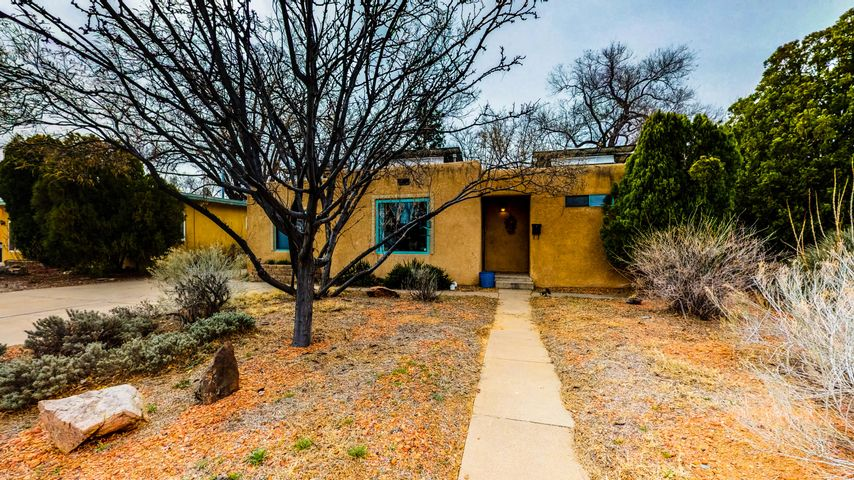 Beautiful home located in the UNM South - Ridgecrest/Parkland Hills area! 100% owned solar panels - PNM pays Seller every month for electricity *See utility bills in documents*. New water heater (2018) and PVC sewer pipe (2017). Beautiful, updated kitchen w/ stainless steel appliances, bathrooms, electricity, and heating and cooling throughout the house *floor furnace has been converted*. The interior of the home features a Kiva wood-burning fireplace, Cove ceilings, hardwood floors, and separate laundry room. The large-private backyard features mature shade trees, fruit trees *peach, apricot, and pear*, gardening area, hot tub, sprinkler/drip system, and storage shed.  3rd bedroom can be used as an office. Washer, dryer, and refrigerator is included. Minutes from Nob Hill and UNM Campus.