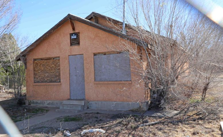 Just under an acre of commercial zoned property in a great location with a 100+  adobe fixer-upper! How do you say opportunity?  Here's your chance - right on Isleta! Fix it up and live in it or open a business, car wash, laundry mat,  etc.  Rare opportunity to have a drive through in this area. Price is based on the land value ONLY with no value given for the home.  Property sold ''as is.'' No repairs will be made. Across from Martin Brothers. Lot next door is for sale also.