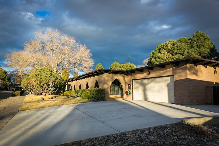 OPEN HOUSE 3/23/19, 1-3 PM LA SALA GRANDE SUBD; Large covered portal w/multiple arches invite you to this One-of-A-Kind  & unique custom HM built by George Chant. Striking Slumprock Circular living space w/12' tongue-in-groove ceiling & wood beams; centrally located w/ multiple access points for an ideal entertaining traffic pattern. Incl; Skylights, Alder wood entertainment center & wood burning fireplace. Chef's  kitchen; solid wood Coppes Napanee cabinets, deluxe pantry, 2-Stoves, 3-Ovens, butcher block island & large breakfast nook. Spacious master Ste w/two sided Opti-Myst Fireplace/Humidifier, 2-walk-ins, double sink, jetted tub & separate shower. Two bedrooms w/Jack & Jill bath are on the other end of the home, can be used as an In-Law suite/office/multi-generational living!