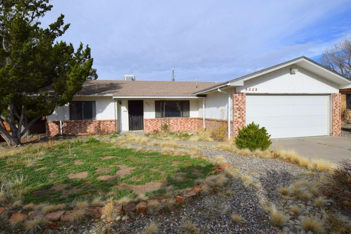 Estate sale home.  Opportunity in Loma del Norte to remodel to your specs.  2 living areas, service room, entry foyer.  Endless possibilities.  Home needs updates.  Home has been owner occupied.  Close to La Cueva high school, shopping and good access to I-25.