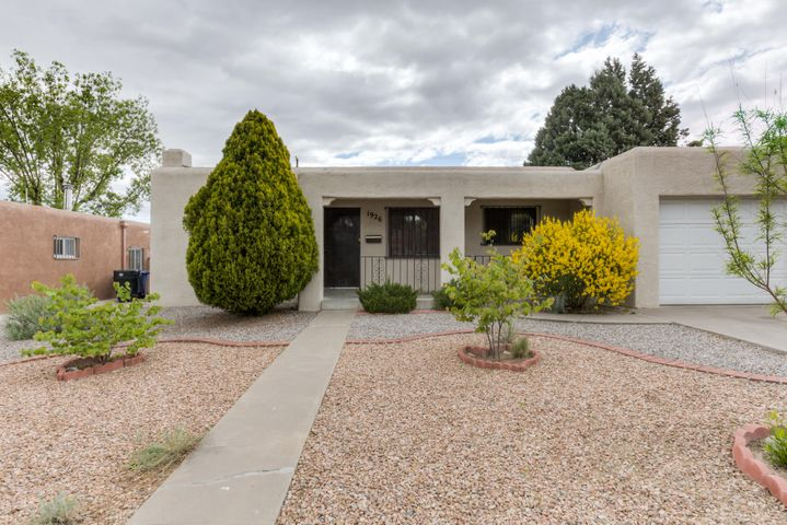 FABULOUS PRICE ADJUSTMENT: Priced right and ready for new owners!! This UNM Pueblo 1 story gem is waiting for you. 3bd 2ba 1cg w/two living areas and separate formal dining rm. Beautiful refinished original hardwood floors, and new laminate planks in large family room.  The master suite has new carpet, walk-in closet and large bathroom. Low maintenance professionally landscaped yards; backyard has a covered patio, gas grill,BACKYARD ACCESS and storage. HUGE laundry room. 2 refrigerated air units, 2 heaters, 2 water heaters, resurfaced roof 2010 and re-roof over master suite. Updated outlets and double pane windows w/new 2'' blinds. Great location; close to I-40, shopping and restaurants.