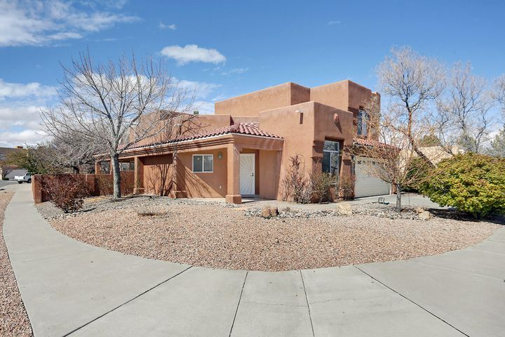 PRICE REDUCED on this Beautiful pueblo style home on a large fully landscaped corner lot. Open floor plan with raised ceilings. Large corner Kiva fireplace.  Saltillo tile, butcher block counter top on the kitchen breakfast bar, stainless steel appliances and Upgraded lighting. Two bedrooms and full bath downstairs. Master bedroom with a sitting area, small deck, full bath with double vanity and walk in closet upstairs. The front room is great as a study, office or library. Lots of natural light throughout. Wrap around covered patio. Two storage sheds. Raised bed garden area.