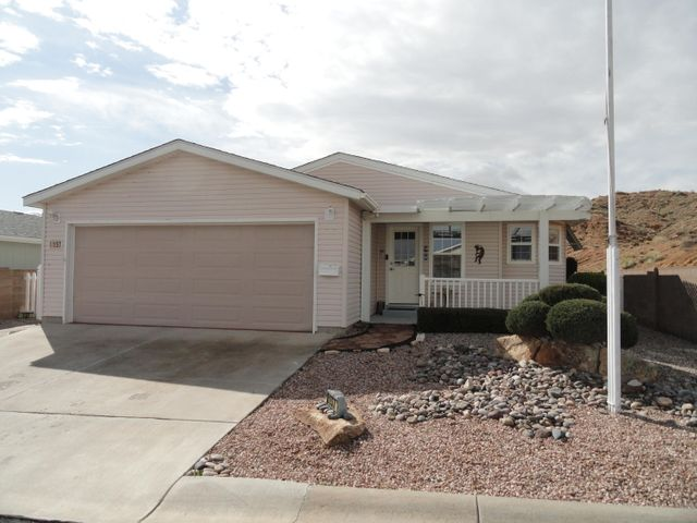 Beautiful home located in Sunrisebluffs 55+  community. Large home in private street end location.  Home features Big kitchen with upgraded appliances, pullout lower cabinets, 3 rack electric range, newer refrigerator, island with power,  freezer, and water softener. Master has walk in shower with bench and double sinks with one raised. Sunroom off master is insulated.  Guest bedroom is super functional/spacious,  has Murphy bed which will stay.  Home has cellular shades through out. Garage is insulated and finished w/ auto opener. Very low maintenance yard with auto drip for landscaping. Insulated front patio cover offers quiet outdoor entertaining. Professionally installed. Neighborhood enjoys club house with year round pool, exercise room, and kitchen and dining area for parties.