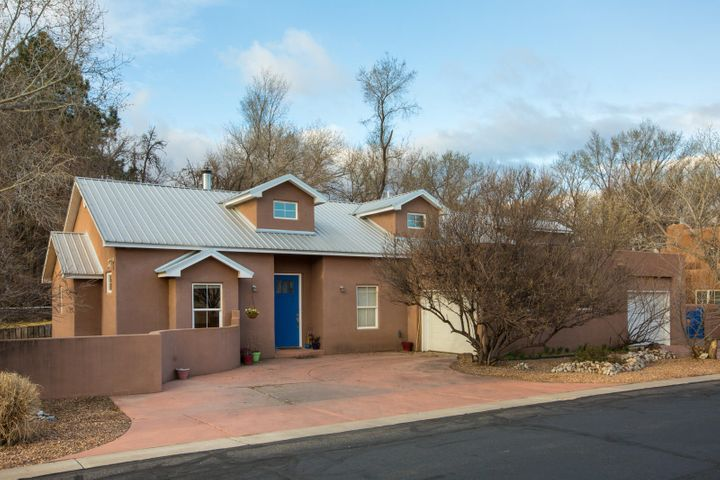 Contemporary Custom Northern NM Style Home in Prestigious and Private Rancho Guadalupe Gated Community in Serenity of  North Valley !  Home Features 4 Spacious Bedrooms with Walk-in Closets , A Stylish Home office, Chef's Kitchen with Stainless steel Appliances , A Bonus 226 Sq Ft Loft not included in the Square footage , Rounded Walls and Ceiling with Niches , Recessed Lighting, Solid wood Doors.  Combinations of Hardwood Floors in Living areas , and Tile floors in Kitchen and Bath .  Oversized Private Master bedroom with Private Combo Steam room / Shower , Teenage Quarter with private Bathroom  , Custom Oversized L-Shaped Garage, Back yard Access gate for Boat or RV parking, Water filtration system , Access to Ditch / Walking Trails & Much More...