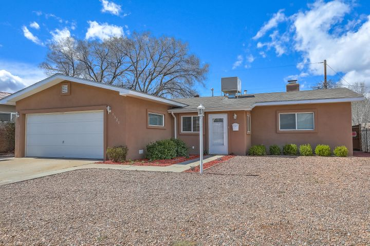 Come see the fine details of this Updated home in a great location. Completely remodeled Kitchen with newer stainless appliances and updated countertops. Wired under upper cabinet lights.  Newer stucco, windows, light fixtures and ceiling fans. New Master Cool 2018 summer. Tile and Laminate throughout. Outdoor living at is finest with large covered finished patio, stucoo yard walls and beautiful landscaped back yard.