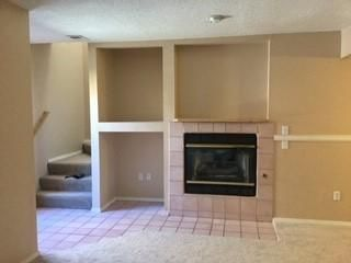 Two large bedrooms, 1.5 baths, interior access from 1 car garage with opener.  Gas fireplace, fenced patio.  New flooring. Located in quiet neighborhood.  Well maintained grounds.  Close to mall, shopping, restaurants, grocery, etc. Move in ready.