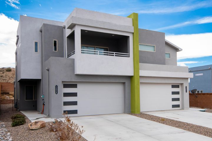 This home offers exactly what you would expect from a contemporary, luxury home. The home boasts a coveted NM Green Build Silver Rating which includes 2x6 construction, blown in insulation, tankless hot H2O system, refrigerated air, low E windows plus more! Entering through an 8' leaded glass door you'll find comfort in 9' ceilings leading to a gourmet kitchen delivering luxurious silestone counter tops, upgraded hickory cabinets with nickel hardware, decorated backsplash, an elegant 10' island with ample storage, walk in pantry and stainless appliances. Upstairs you'll find the Master bedroom that includes dual lavatories, walk in shower with shower seat, an enormous walk in closet, and its own private covered balcony where you'll enjoy amazing north facing views of the Sandia Mountains!