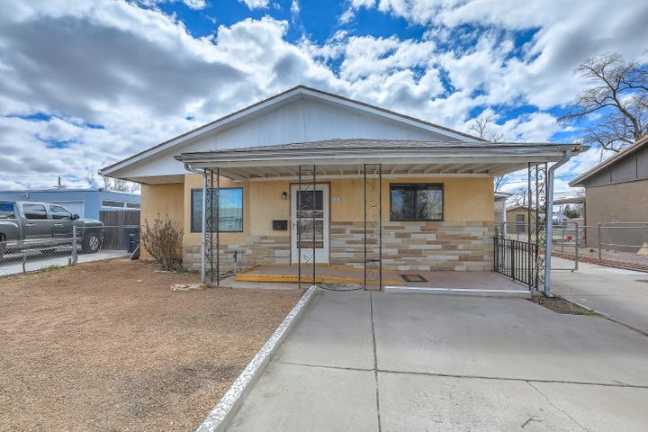 Three large bedrooms, two bathroom home near the North Valley. Blocks from the Indian Pueblo Cultural Center. Short drive to Downtown. Close to Old Town. Centrally located for quick commutes anywhere in town. Updated kitchen with 5 burner gas stove, granite counters and tin backsplash. Large pantry, Large open plan living and dining area with space for 2 living areas and eat-in kitchen and separate dining area. Solid surface shower enclosures. Hardwood floors throughout. Carpet in master bedroom, Tile in bathrooms and kitchen. Backyard access through carport. Fully fenced backyard. Large workshop with electricity.