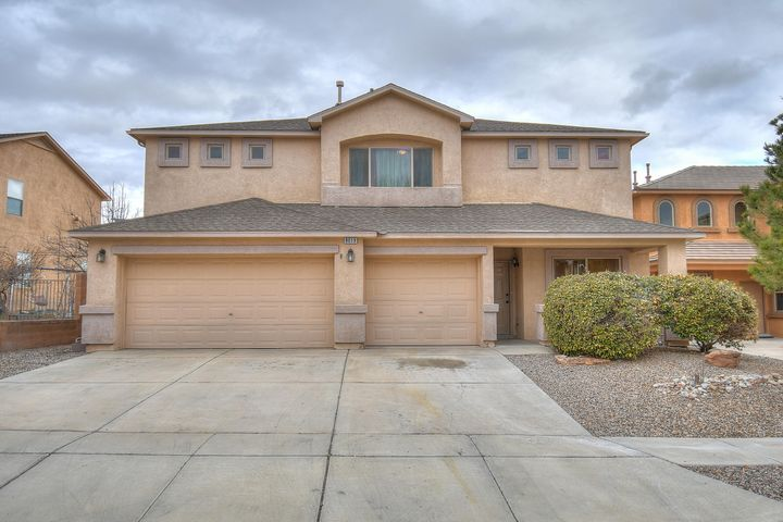Absolutely beautiful home in desirable Ventana West! This home is move in ready and waiting for it's new owner. Two living areas, open concept, bay windows, and raised ceilings and a three car garage are just a few of the amenities. Awesome kitchen with island, pantry and breakfast nook. Upstairs you'll find a nice loft, an extra large master suite, master bath with garden tub and separate shower. Enjoy outdoor living on the front and back covered patios. Beautifully landscaped grounds with a mixture of trees, and desert plants. Close to CNM, shopping, dining, walking trails and more. This one is a must see!