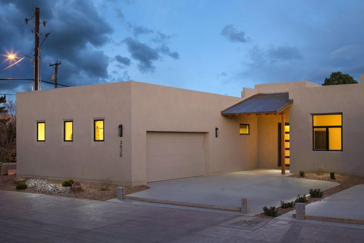 Just when you thought it was impossible to find a brand new, one story, energy efficient home in the heart of the North Valley!  The award winning model home in Bishops Compound is now available for sale.  Located in a small development snuggled off Candelaria and Rio Grande, this project encompasses 9 one level homes.   Boasts all the quality finishes you have come to love in a Las Ventanas property....tile floors, granite countertops, stainless appliances, Pella window package, 12 foot ceilings, solid wood doors, Emtek hardware, LED lighting, epoxy floors in the garage, tons of skylights and the NM Green Build Silver certification. Low maintenance landscaping.  We are sold out of this neighborhood and this is the last home remaining.