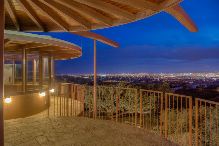 Award winning Bart Prince design built for his father in North Sandia Heights with FOREVER Views. Multi level plan with exposed beams, lots of light inc custom designed skylights and full walls of windows. An architectural marvel! Terraces & decks on all sides joining the outside and inside spaces. contemporary design inside and out. Incredible architectural detail, see to appreciate! Kitchen has granite counter tops. 2 BR's with Jack & Jill bathroom separated from MBR. Kiva style office with windows all around. Wrap around patios for sunset and city light views. Almost 1 acre bordering open space. BIG 3 car garage w/ storage.  This house is ready to be lovingly restored or updated & is priced accordingly. Check the comps! Some inspections done, call LA for details & copies