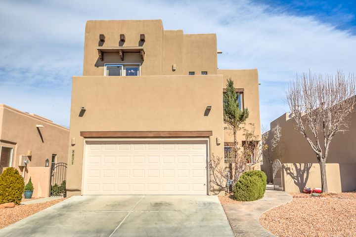 Welcome to this beautiful home in the gated Desert Ridge subdivision, just north of Paseo Del Norte. Home has a great open floorplan with raised ceilings and tons of natural light. Large open kitchen with granite counters and sitting area, pantry with tons of storage. Laminate wood and tile floors downstairs. Master suite is on the main level with walk in closet, jetted tub and his and hers sinks. This home features great outdoor living areas with a gated front courtyard, covered back patio with outdoor built in grill and fireplace, and small nook for storage or possible dog run. Call today for a private showing.