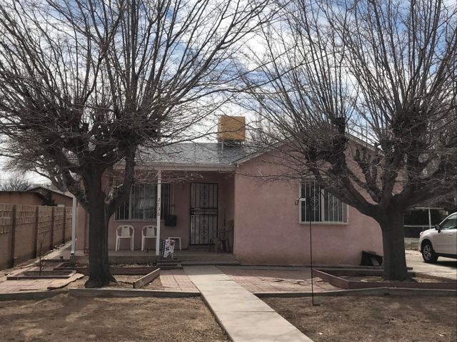 Great location in hidden area within walking distance of Bio Park, ditches and bosque trails.  Near the end of a quiet cul-de-sac.  Well-maintained house with new carpet (2019) and new roof (2018).  Swamp cooler - 2015. Hardwood floors under carpet in living and dining rooms, hallway and bedrooms. 2 full baths. 2 large bedrooms. Deep driveway provides lots of parking. Windows have been replaced. Security bars. Pleasant shaded front porch. Kitchen opens to dining area and living room