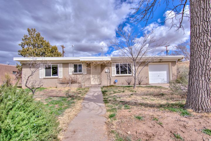 Charming 1 story, UNM area home.  This beautiful home boast 4 great bedrooms and 2 bathrooms.  Fall in love with the original wood flooring that have been newly refinished.  Enjoy the spacious family room.  Schedule a showing of this charming home today.