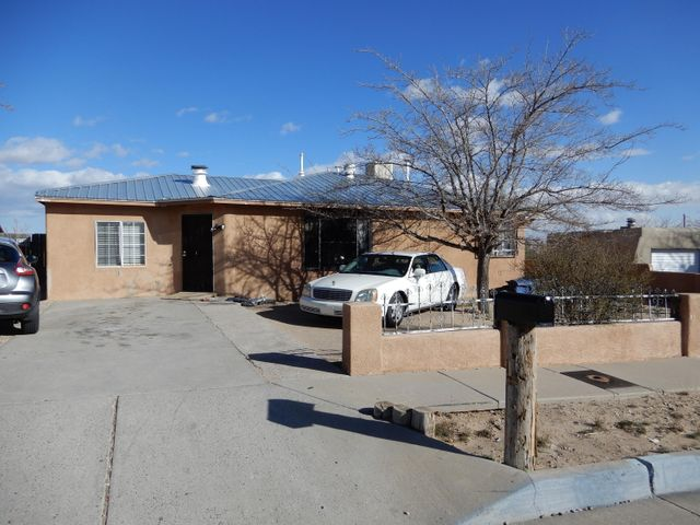 Wonderful investment property. 3 bedroom 2 baths. With back yard access.