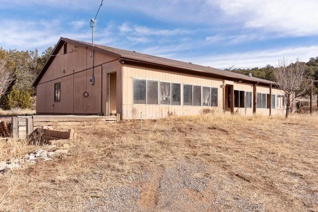 Plenty of living space on approximately 3 acres for a great price. This single story homefeatures 6 bedrooms, 3 baths, a large kitchen that opens to a nice living room.Property is in need of some TLC but could be a great value with a little work.