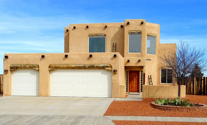 This unique, immaculately-maintained two-story pueblo-style home perched high on a Westside cul-de-sac is a must see! Wonderful views of Sandias from master bedroom, dining area and custom-built backyard ramada. Open floor plan includes spacious great room w/tongue & groove viga ceiling and kiva-style gas fireplace. Loft overlooking great room leads to master bedroom suite w/kiva-style gas fireplace, double-sink tiled master bath w/Jacuzzi tub. Additional features: third garage, new dual-level heating/cooling system (refrigerated air downstairs/mini-splits upstairs), custom kitchen w/gas range, and glass-fronted cabinet, new flooring in master bed, bath and walk-in closet, rustic wood doors throughout, custom-built storage building and xeriscaped landscaping. Come see your new home today!